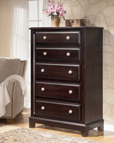 Ashley Ridgley B520-46 Signature Design Chest - When entertaining guests and family, you want to make sure that the accent pieces in your living space have the proper colors of warmth, invitation and general beauty. Within this collection, you can find all that and more. Please make yourself at home with this and other great furniture pieces from Ashley Furniture.