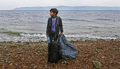 Photo: A boy carries his belongings upon his arrival on the island of Lesvos after having crossed the Aegean Sea from Turkey in a rubber dinghy, Lesvos island, Greece, 11 October 2015. EPA/YANNIS KOLESIDIS