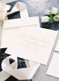 Wedding papers suite by Lady Letterpress, calligraphy by Lydia Robins Hendrix, image by Landon Jacob. See more in the Winter 2014 issue of Weddings Unveiled: www.weddingsunveiledmagazine.com.