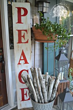 DIY Peace Sign for Christmas….. - Cottage in the Oaks. Simpler version would be to buy wood letters, paint, and glue to board...et voila...