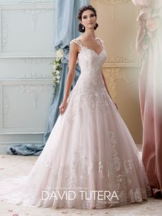 David Tutera for Mon Cheri style 215277, Arwen is a princess-like pink wedding dress from the Fall 2015 Bridal Collection. Click for more details.