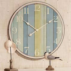 """oversized clock would be fun next to the big pillow that says """"on beach time""""  idea - minimal headboard in guest bedroom. big clock above bed. pillow mentioned above on bed. along with another pillow that pulls out clock colors. guest bedroom would be soothing beach (guest might appreciate the getaway/serenity of that!) with splashes of beach for sure. ....."""
