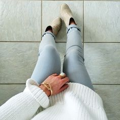 White Sweater + gray Jeans.