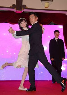 Chinese actress Tang Yan dances with Hong Kong actor Hawick Lau at a press conference for their new drama 'Lady and the Liar' in Shanghai, China, February 19, 2014