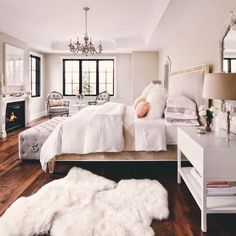 I love this bedroom, but the chandelier belongs in the dinning room, not the bedroom. There needs to be a hanging fan there instead.