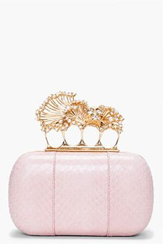 "ALEXANDER MCQUEEN //  PINK SNAKESKIN KNUCKLE BOX CLUTCH  21259F067024    Smooth scaled whipsnake skin box clutch in pale pink. Gold tone trim and skull carry handle clasp at front. Clear Swarovski crystal accents and faux pearl accents at skull carry handle. Lined. Approx. 6"" length, 4"" width, 2"" depth. 100% whipsnake skin Made in Italy.  $2895.00 USD  $2026.00 USD"