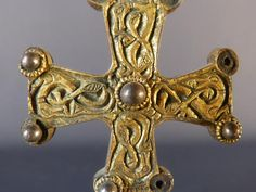 Merovingian cross anglo saxon with fantastic animals Golden bronze cross of Anglo-Saxon style, with interlace decoration of fantastic animals and cabochons of silver, 6-8th century AD