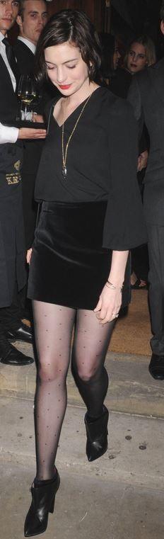Who made Anne Hathaway's black velvet skirt, ankle boots, handbag, and shirt?…