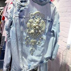 Talk about statement piece! IWANT! This distress embellished oversize denimhellip