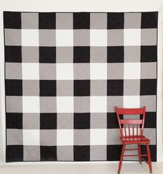 The perfect quilt to make for any teenage boy in your life. The Black and White Gingham Quilt is simple to make using pre-cut fabrics and looks amazing!