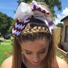 Braided, high pony tail, cheer hair! Followed with a chevron name bow.  Perfect for Cheer!