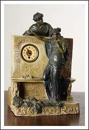 Scultura in terracotta con orologio.  Marcata sul retro: Ceramiche Treviso - E. Lazzar.