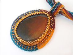 The beads colors enhance the cab. Unique Bead Embroidery Necklace Agate blue by NoraTordaiJewelry