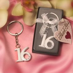 """$1.50-$4.00 Baby It's easy to show your parental pride on her special day with these Sweet 16 key ring favors She'll always be your little girl, but today she celebrates turning Sweet Sixteen - and these key rings make the perfect party mementos. Each measures 3"""" by 1"""" and features a bold 16 decorated with rhinestones, attached to a metal chain and ring. Part of the own collection of key ring fa ..."""