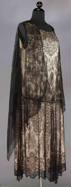 """SILK & LACE EVENING GOWN, 1920s  Black lace in floral & vermicelli designs, drop-W w/ rhinestone band, attached back lace cape, B to 46"""", H to 46"""", L 49"""""""