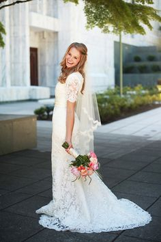 Modest lace wedding gown with 3/4 sleeves. Avenia Bridal. View More: http://haleygrahamphotography.pass.us/brooklynnandcameron