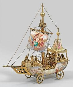 The boat is made of silver and beautiful painted enamel on copper and brass. Sails and hull are upholstered in silk and decorated with beautiful mythological genre scenes in the spirit of the French rococo XVIII century.