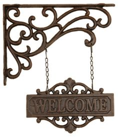 Welcome guests to your barn with this old world cast iron sign. 'Welcome' Cast Iron Hanging Sign @www.RuralAccents.com $19.99