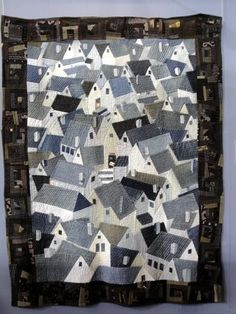"createcreatively:    by Reiko Nishida. The center of the quilt is made from denim jeans! The border is made from a traditional Japanese fabric called ""Kurumekasuri"""