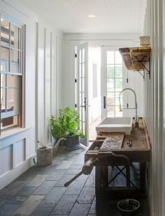 American Farmhouse interior windows, french doors, potting bench with interior siding and slate floors in back entrance