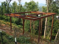 Just days after the fire that destroyed a similar house, this framework goes up to create another house where no corner even touches the ground. Steel Frame House, A Frame House, Modern Tropical House, Tropical Houses, Cliff House, River House, Pole House, Hillside House, House Foundation