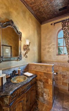 Tuscan Powder Room - would do a different sink and counter top, darker wood window, with a different mirror and lights.