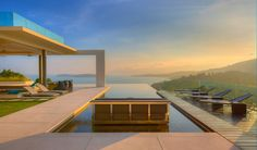 http://sandavy.com/mesmerizing-natural-spectacle-offered-by-modern-holiday-villa-in-koh-samui-ideas/wooden-flooring-grass-ceiling-fan-luxury-villas-and-homes-koh-samui-natural-beach-view-trasparent-piece-windows-sunset-beautiful-landscapes-exterior-koh-samui-villa-lounge-chair-cozy-sofa-glass-fence/