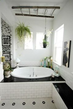 Hanging plants over the bathtub is a great way to incorporate plants in the bathroom.