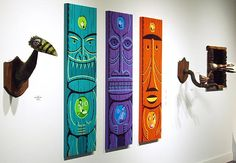 "Three acrylic on panel works by Shag, perhaps the most visible artist of the modern tiki genre, are flanked by recycled acrylic paint and carved driftwood works by Tiki Tony on either side. Their titles are (L-R): ""Hopping Wicky Bird"", ""Ekahi"", ""Ekolu"", ""Elua"" and ""Wickensburg Chicken."""