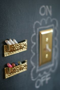 Must do a chalk board wall in the kids playrooM! Upside down drawer pulls for chalk holders this would be precious for the kids playroom, paint one wall with chalkboard paint and let them create their own masterpiece as often as they want!