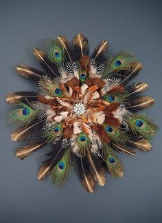 This dramatic decor idea is going viral on Pinterest—here's how you can make it yourself: Peacock Wreath, Peacock Crafts, Feather Wreath, Feather Crafts, Feather Art, Peacock Feathers, Pheasant Feathers, Parrot Feather, Feather Wall Decor