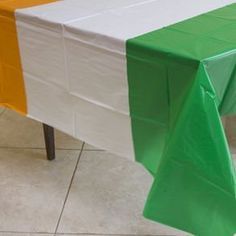 "Irish Flag Tablecover by Century Novelty. $4.89. Have a Happy St. Patrick's Day with Decorations! The Irish flag tablecover is the perfect decoration for your St. Patrick's Day party. A fun and easy way to add some Irish style to your event. 54"" long and 108"" wide. Fits most standard size tables. Green, white and orange stripes to match the colors of the Irish flag. Made of plastic. Show your Irish pride with St. Patrick's Day decorations. Cover every room in green with our St..."