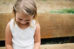 Jr bridesmaids are the CUTEST! This adorable little one was part of a beautiful rustic country barn wedding in Onalaska Wa.  Photo by: TGTB Collective