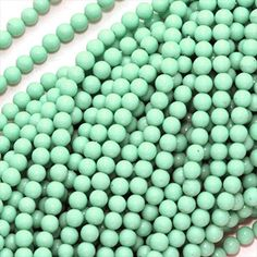 TURQUOISE STABILIZED TINY 25MM ROUND BEADS 16 INCH STRAND from beadaholique.com