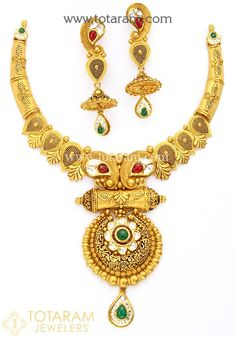 22 Karat Gold Antique Necklace & Drop Earrings Set with Fancy Stones & intricate workmanship.  Gross Gold Weight : 94.750 grams Screw Type : Bombay Screw   Gold Weight of Necklace : 69.550 grams Gold Weight of Earrings : 25.200 grams Length of Center Pendant of Necklace : 3.95 inches Width of Center Pendant of Necklace : 2.05 inches Width of the sides of Necklace : 0.45 inches Length of Earrings : 2.65 inches Width of Top : 0.55 inches Width of Jumkhas : 0.90 inches