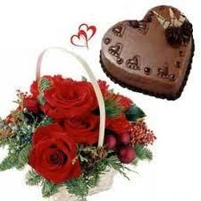 12 roses basket with fillers and greens and 2.2 Lb heart shaped chocolate cake