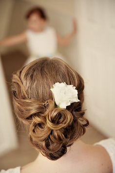 Pretty wedding updo with hair flower {Photo by Josh Goodman via Project Wedding}
