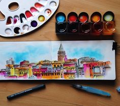 Bilgehan Güzel, the artist for our Turkey box, is a watercolor painter and graphic designer from Ankara, Turkey. Bilgehan paints a veritable tour of Turkey, capturing not only the sights but the sp…