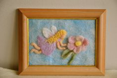 Waldorf inspired needle felted Fairy Tale/ Wool Picture: The Flying fairy and the pink flower. $48.00, via Etsy.