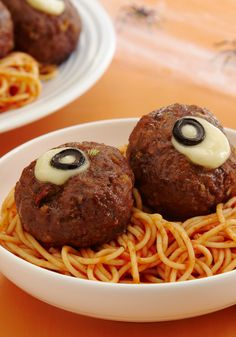 """Spaghetti and """"Oozing Eyeballs"""" — Oozing meatballs bursting with cheese are the perfect compliment to spaghetti. This fun Halloween recipe is sure to be a favorite in your home!"""