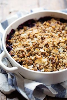 Simple Oat and Blueberry Crisp - a coconut, oat, and pecan crumble baked over juicy blueberries! | pinchofyum.com #blueberry #crisp #recipe ...