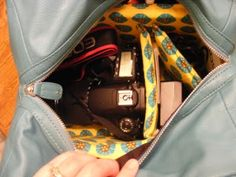 Make your own stylish camera bag, well insert for any stylish purse to become a camera bag :0) Genius!