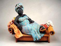 Title : Reclining Figure with Cat Description : Ceramic Sculpture Artist : Annie Peaker African American Figurines, African American Art, Human Sculpture, Sculpture Art, Afrique Art, Fat Art, Art Corner, Pottery Sculpture, Arte Popular