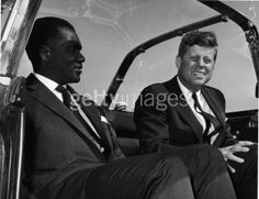 """John F. Kennedy with Abraham Bolden, the first black Secret Service agent assigned to the Presidential Protective Division, appointed by JFK in 1961. Kennedy once introduced him as """"the Jackie Robinson of the Secret Service,"""" a comment which brought tears to Bolden's eyes."""