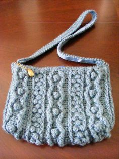 Crocheted purse, again the Bobbling Along pattern, this time in slate blue (goes with my jeans, dontcha know!).  Crocheted strap lined with grosgrain ribbon, fully lined with zipper closure featuring one of my polymer clay beads as a zipper pull.