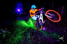 Photographer Marcelo Maragni created some homemade black light flashes and used them to shoot colorful action shots of downhill bikers riding at night.