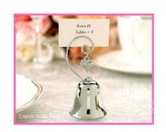 Possible wedding favor and name card holder.the bells signal a kiss for the bride and groom, kinda like the spoon against the glass cup. Charming Silver Bell with Dangling Heart Charm (Set of - - Place Card Holders Gold Wedding Favors, Elegant Wedding Favors, Bridal Shower Favors, Wedding Gifts, Wedding Bells, Wedding Souvenir, Party Favors, Wedding Table, Wedding Reception