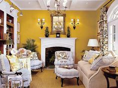 The designers created a library atmosphere for this living room with a fireplace setting and built-in bookcases.