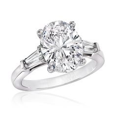 1 carat circle engagement ring with baguettes - Google Search