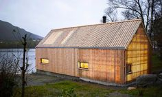 Oslo-based studios Koreo Arkitekter and Kolab Arkitekter transformed an old wooden boathouse into a stunning summerhouse called 'Naust V'.